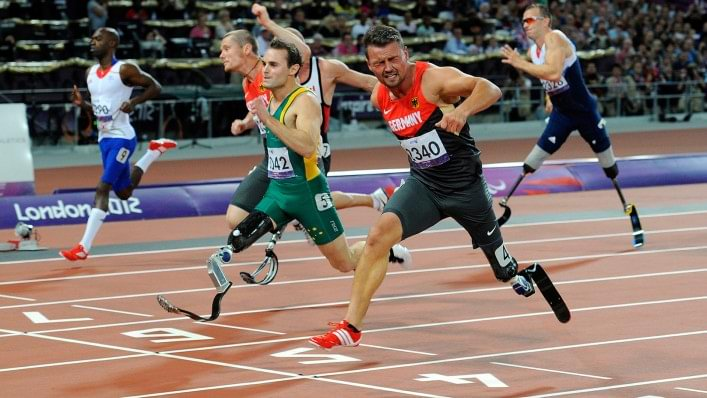 Heinrich Popow reaches for the line to win gold in the T42 100m at the London 2012 Paralympic Games.