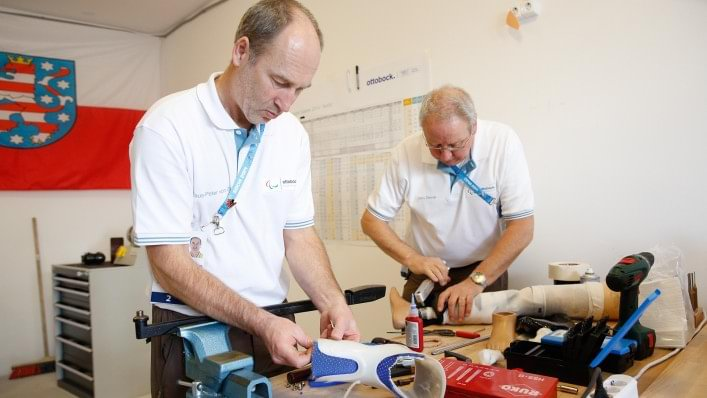 Ottobock technicians work side-by-side repairing prosthetics and orthotics in the Athletes' Village at the Sochi 2014 Paralympic Winter Games