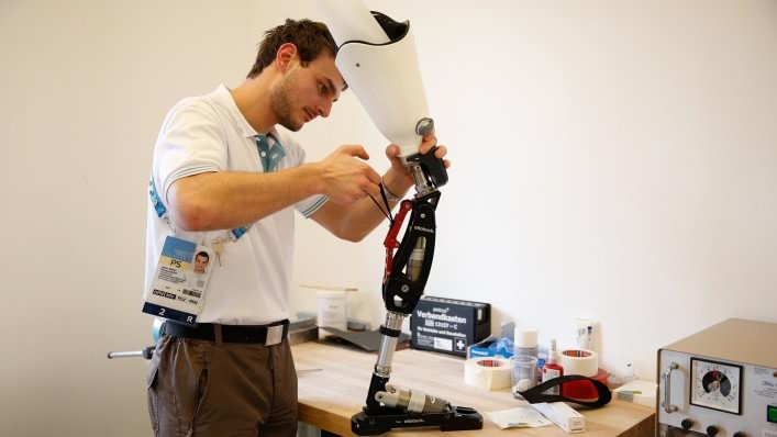 An Ottobock technician repairs a prosthetic leg for alpine skiing at the technical service repair centre in the alpine village at the Sochi 2014 Paralympic Winter Games
