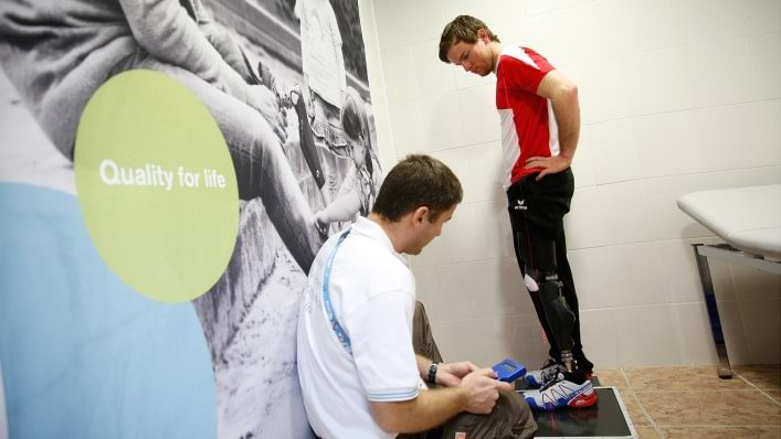 An Ottobock technician aligns a prosthetic for an athlete at the technical service repair centre in the alpine village at the Sochi 2014 Paralympic Winter Games