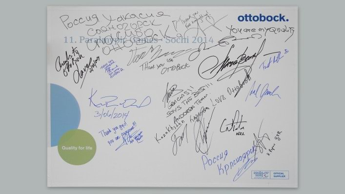 Athletes show their appreciation for Ottobock technicians by signing a board on the wall in the repair centre, which is taken back and displayed at Ottobock's headquarters.