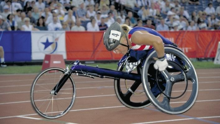 Athlete competes in wheelchair racing at the 1996 Paralympic Games in Atlanta, USA