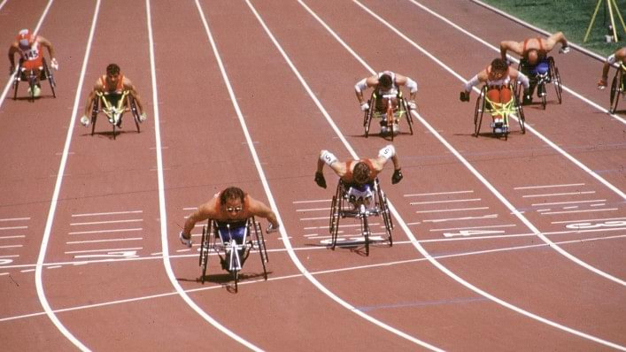Athletes compete in wheelchair racing at the 1992 Paralympic Games in Barcelona, Spain