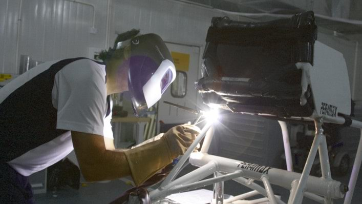An Ottobock welder mends a wheelchair at the Beijing 2008 Paralympic Games