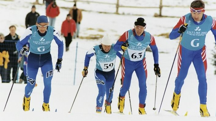 Athletes with a visual impairment compete in cross-country skiing at the Salt Lake City 2002 Paralympic Games