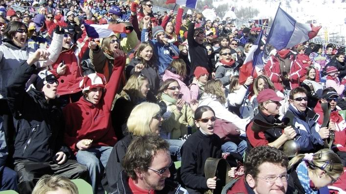 Spectators cheer on athletes at the Turin 2006 Paralympic Games