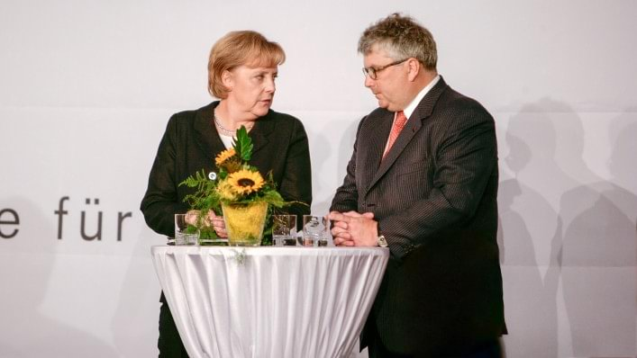 Professor Hans Georg Näder and Angela Merkel at a past festival.