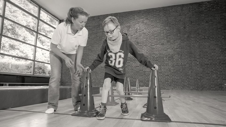 Child with cerebral palsy during a physiotherapy session