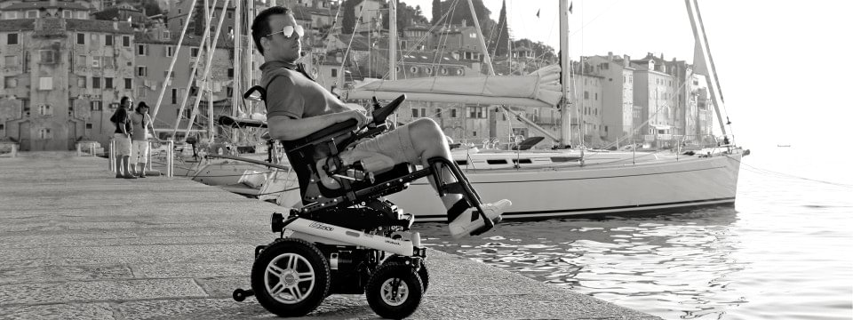 Tomislav using the seat tilt of his B500 power wheelchair to relax.