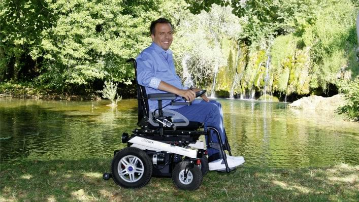 Man at a park in his power chair