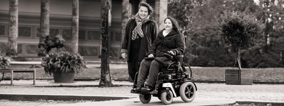 Ottobock Juvo B4 power wheelchair user with a friend in Berlin's city centre