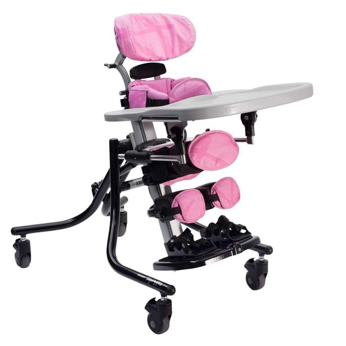 Leckey Squiggles stander with pivot chassis and adjustable chest, pelvic and knee support as well as cushioned sternum pad, removable headrest, adjustable footplate and attached tray.
