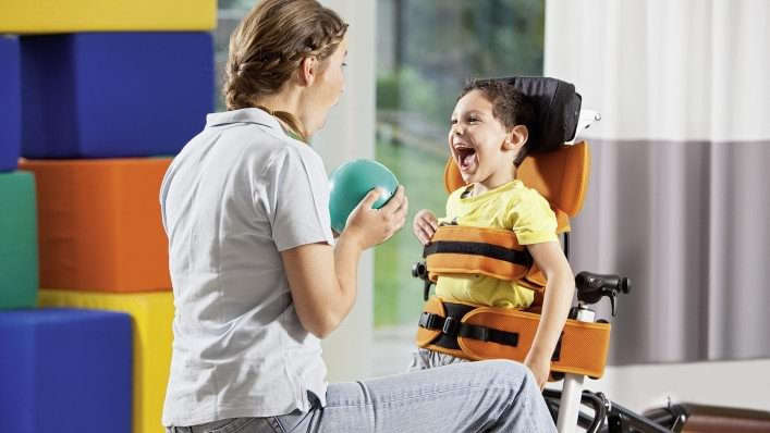 Child in Mygo stander playinga therapy game