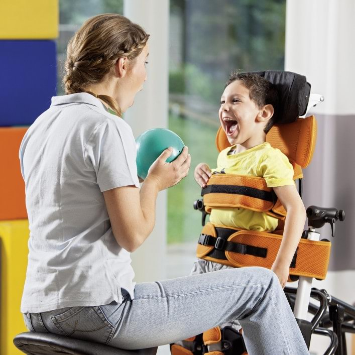 Boy with Mygo stander in therapy