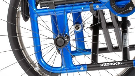 Unique: The permanently welded wheel position on a folding wheelchair.