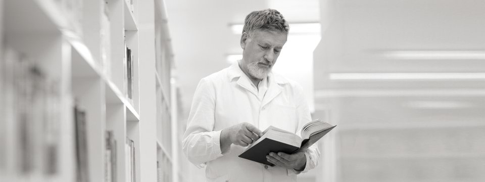 Doctor reading a scientific book
