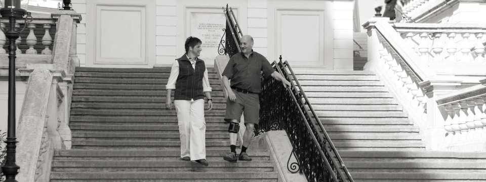 MyGait user walking down stairs with his wife