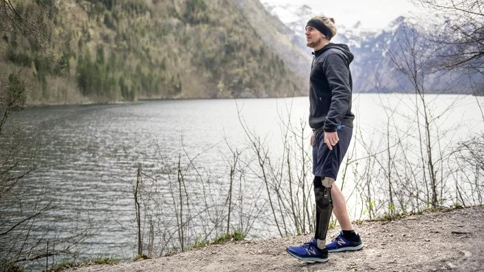 David walks along the lake with his C-Brace® KAFO system