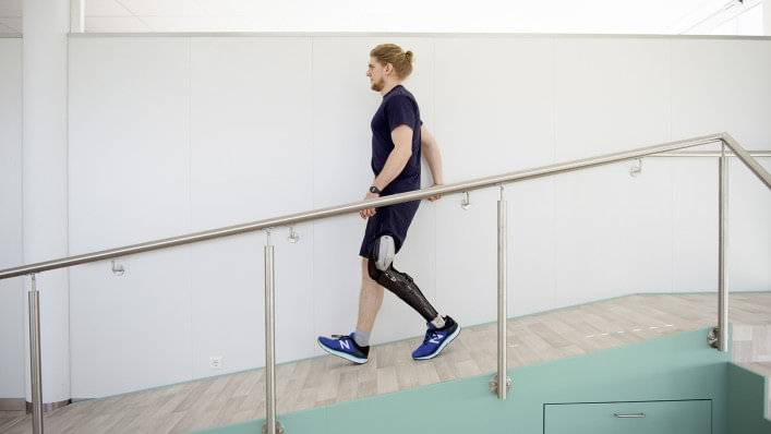 David walks down a ramp with his C-Brace®.