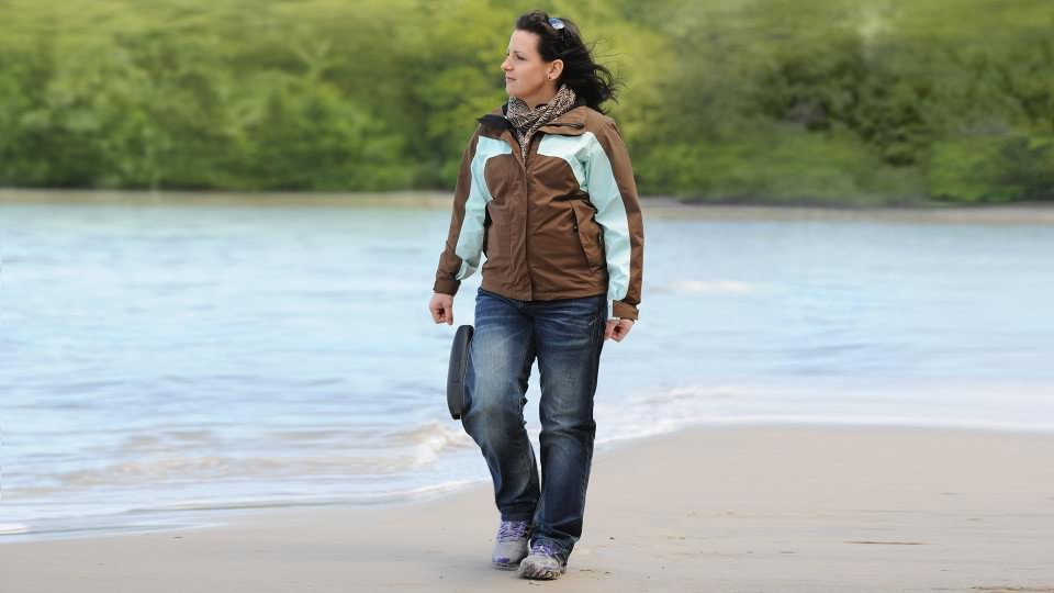 Christin with C-Brace walking on the beach.