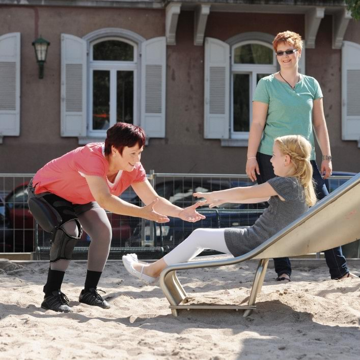 C-Brace® user Karin at the playground with daughter and granddaughter