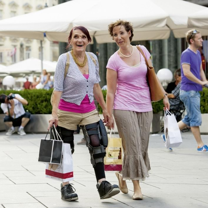 C-Brace® user Lucia shopping with a friend