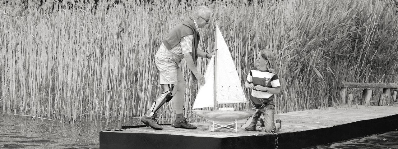 E-MAG Active_ grandfather plays with his grandson by the lake