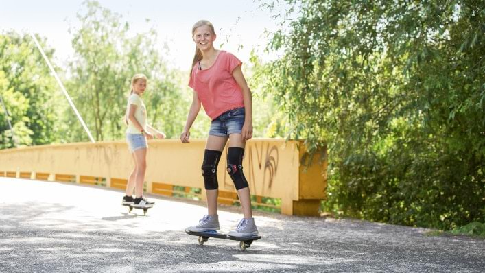 A girl riding skateboard with Patella Pro.