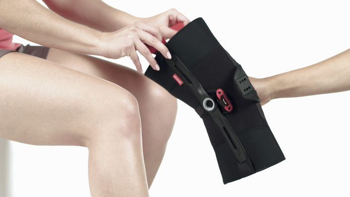 Individual adjustment of the Patella Pro knee brace is demonstrated