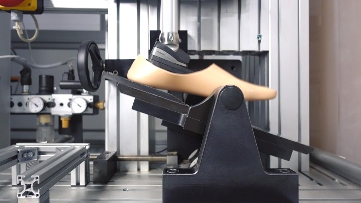 The Triton side flex prosthetic foot is shown on a machine in a test situation.