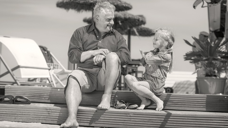 Patient plays with his granddaughter on the beach