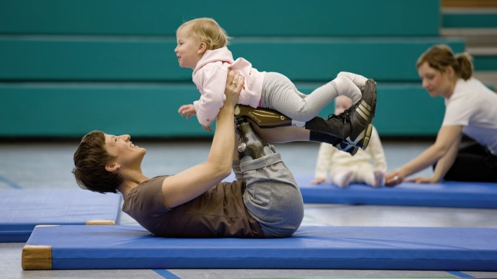 Kathy doing gymnastics with her child