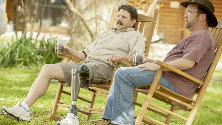 Robert sits comfortably in a rocking chair with his C-Leg.