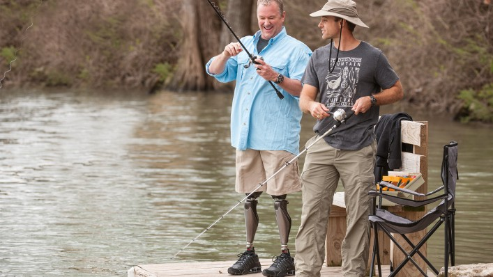 Bilateral Genium user Aaron goes fishing with his friend.