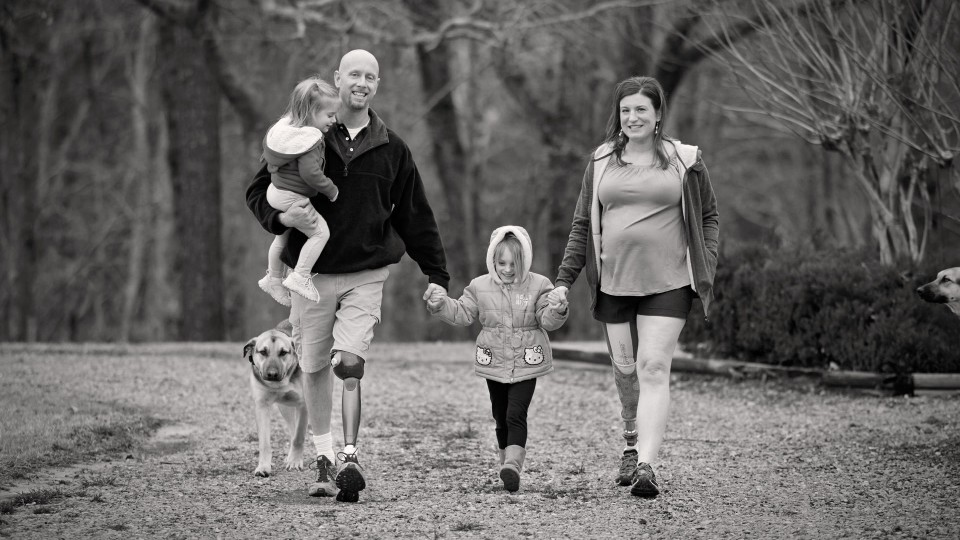Brad and his wife, Jennifer with their Genium knees spending time with their kids and dogs.