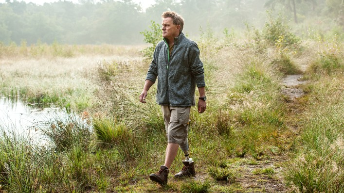 User Hans takes a walk in the countryside with the Meridium prosthetic foot.