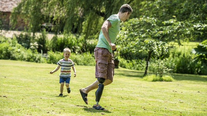 Fun at home in the garden: John plays tag with his young son