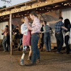 Bailey, a C-Leg user, dances with her boyfriend at a country/western bar
