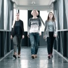 Prosthesis wearer Réka can be seen wearing long trousers in this gait comparison with her two friends.