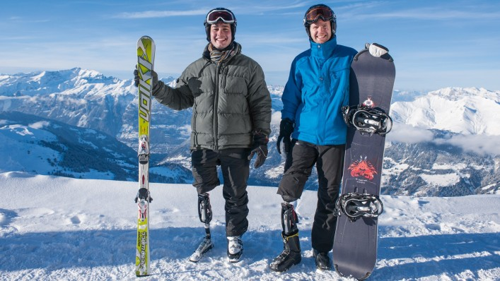 John and his friend on ski and snow board.