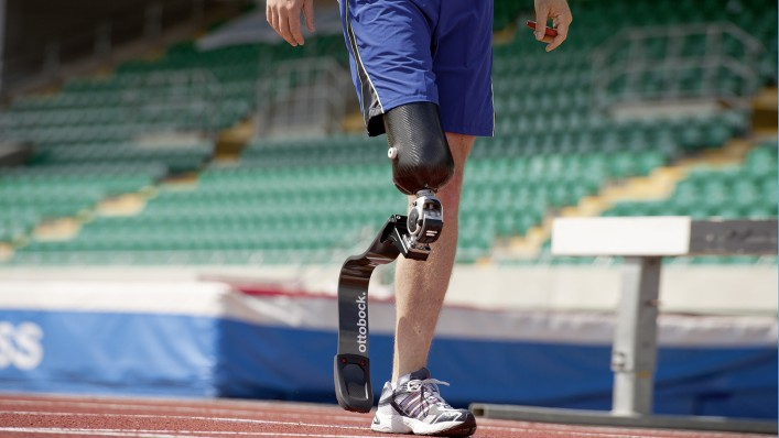 John with Running prosthesis warming up on the track.