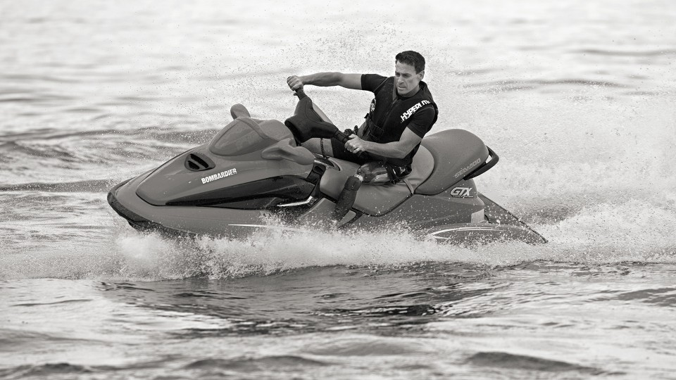 Andrew rides his jetski using the X3 waterproof prosthetic leg.