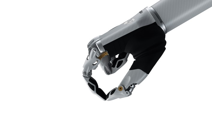 Image of the bebionic hand small in white in the precision closed grip.