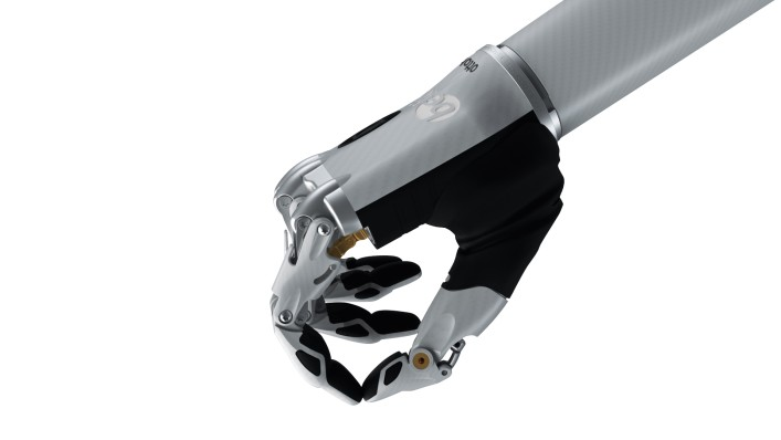 Image of the bebionic hand small in white in the pinch grip.