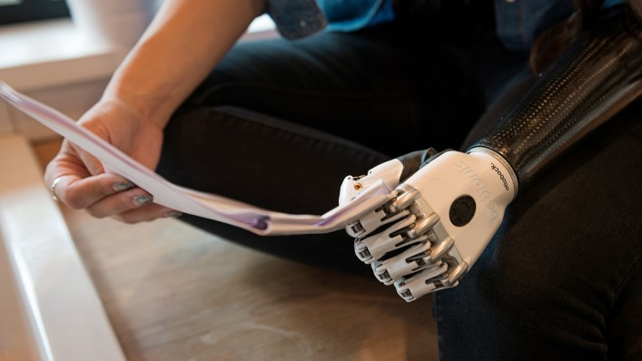 A bebionic user holds a script with the key grip.