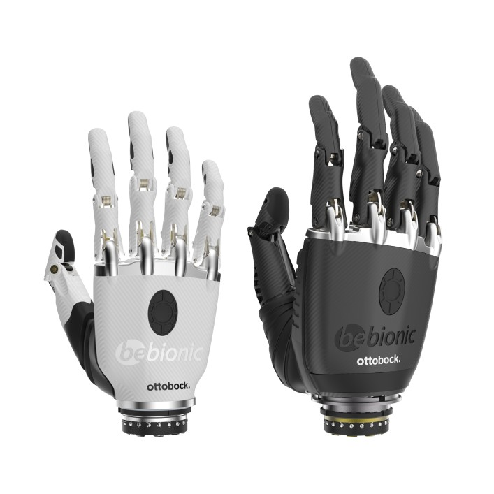 bebionic hand prosthesis in size small and colour white next to a bebionic hand with a prosthetic glove.