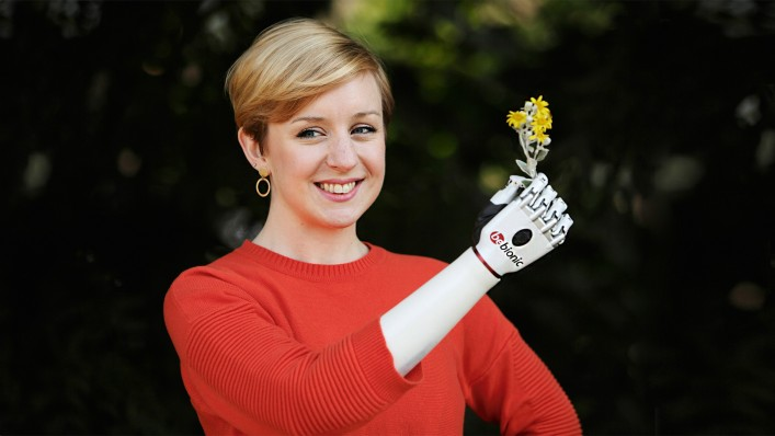 Nicky holding a flower with her bebionic hand
