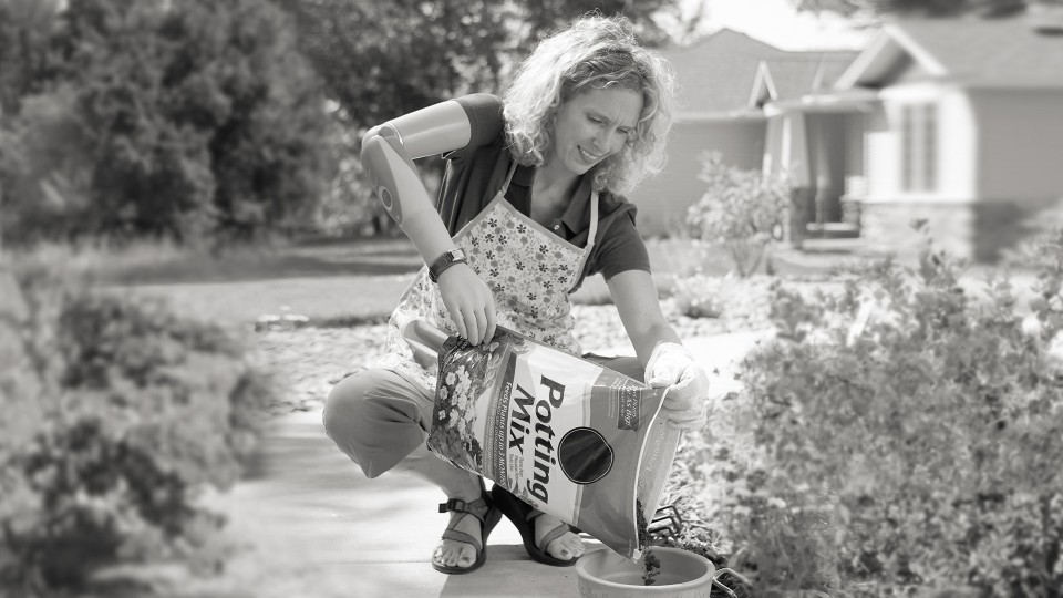 DynamicArm user Sherri plants flowers in the yard