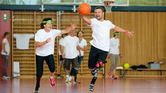 Participants playing basketball with Heinrich