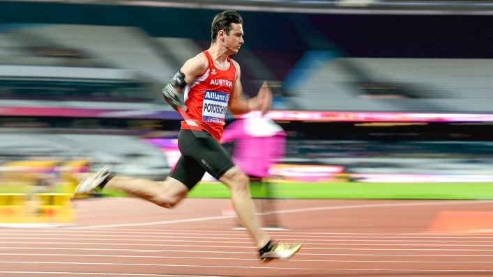 Athlete sprinting on a tartan track